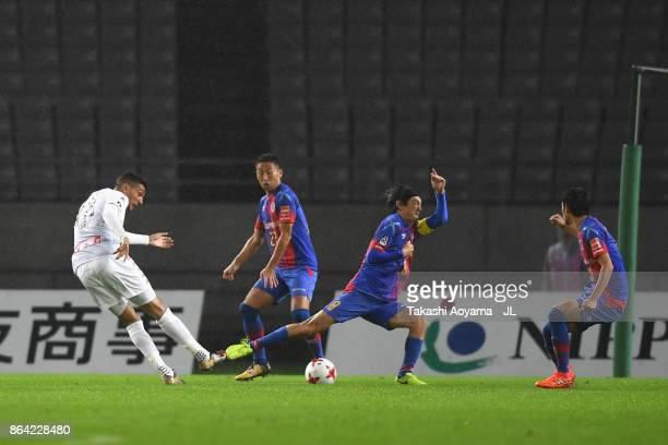 Jay Bothroyd of Consadole Sapporo scores the opening goal during the JLeague J1 match between FC Tokyo and Consadole Sapporo at Ajinomoto Stadium on...