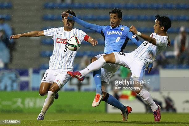 Jay Bothroyd of Iwata competes against Kodai Fujii and Kazuya Okamura of Sanuki during the JLeague second division match between Jubilo Iwata and...