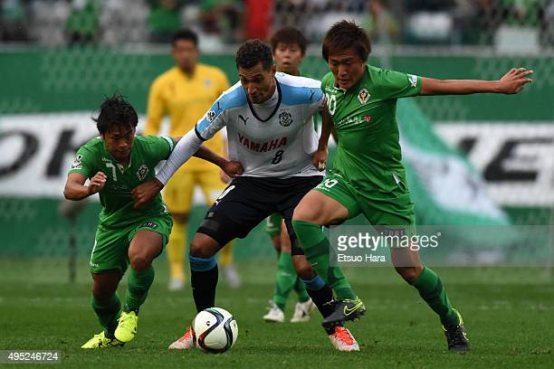 Jay Bothroyd of Jubilo Iwata and Ryuji Sugimoto of Tokyo Verdy and Kento Misao of Tokyo Verdy compete for the ball during the JLeague second division...