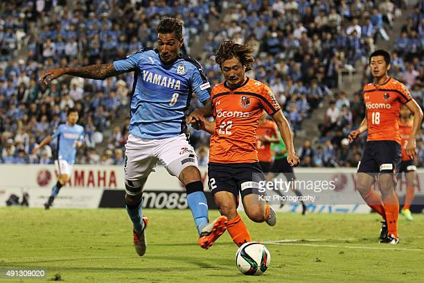 Jay Bothroyd of Jubilo Iwata and Takuya Wada of Omiya Ardija compete for the ball during the JLeague match between Jubilo Iwata and Omiya Ardija at...