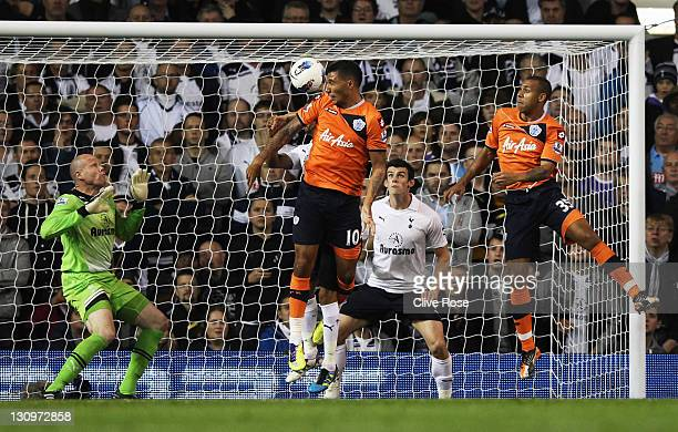 Jay Bothroyd of Queens Park Rangers heads the ball past Brad Friedel of Tottenham Hotspur to score their first goal during the Barclays Premier...
