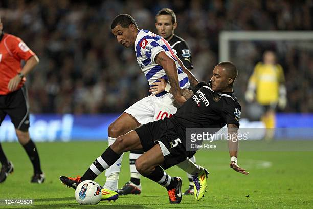 Jay Bothroyd of Queens Park Rangers is tackled by Danny Simpson of Newcastle United during the Barclays Premier League match between Queens Park...