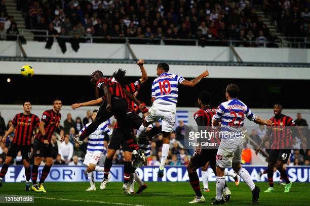 Jay Bothroyd of Queens Park Rangers rises above the Manchester City defence to score during the Barclays Premier League match between Queens Park...