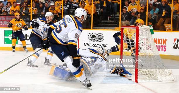 Jay Bouwmeester and Colton Parayko of the St Louis Blues and Viktor Arvidsson of the Nashville Predators watch as Ryan Johansen scores the eventual...