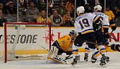 Jay Bouwmeester and Troy Brouwer of the St Louis Blues watch the puck go into the net behind goalie Pekka Rinne of the Nashville Predators during the...