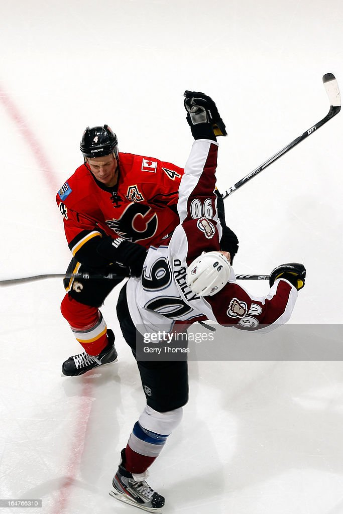 <a gi-track='captionPersonalityLinkClicked' href=/galleries/search?phrase=Jay+Bouwmeester&family=editorial&specificpeople=201875 ng-click='$event.stopPropagation()'>Jay Bouwmeester</a> #4 of the Calgary Flames collides with <a gi-track='captionPersonalityLinkClicked' href=/galleries/search?phrase=Ryan+O%27Reilly&family=editorial&specificpeople=4754037 ng-click='$event.stopPropagation()'>Ryan O'Reilly</a> #90 of the Colorado Avalanche on March 27, 2013 at the Scotiabank Saddledome in Calgary, Alberta, Canada.