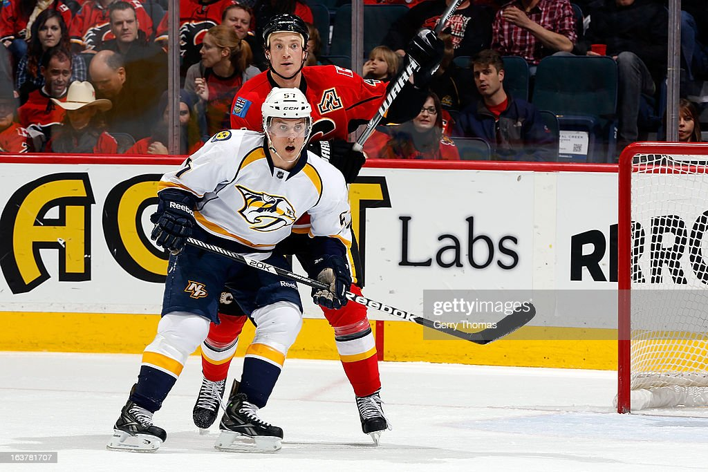 <a gi-track='captionPersonalityLinkClicked' href=/galleries/search?phrase=Jay+Bouwmeester&family=editorial&specificpeople=201875 ng-click='$event.stopPropagation()'>Jay Bouwmeester</a> #4 of the Calgary Flames skates against Gabriel Bourque #57 of the Nashville Predators on March 15, 2013 at the Scotiabank Saddledome in Calgary, Alberta, Canada.