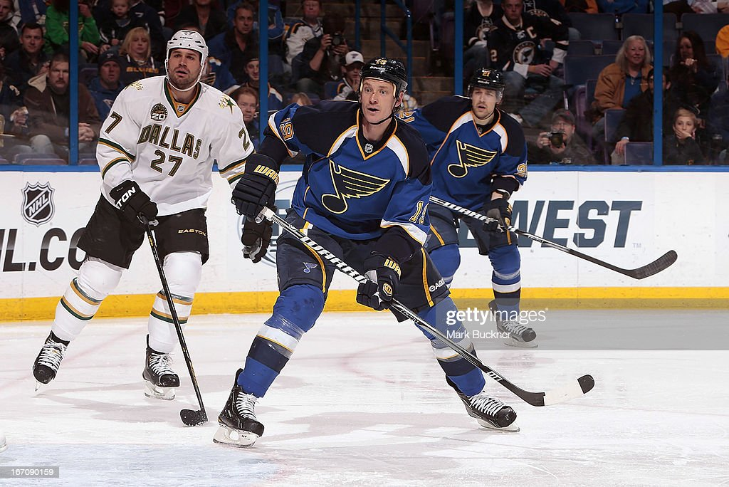 <a gi-track='captionPersonalityLinkClicked' href=/galleries/search?phrase=Jay+Bouwmeester&family=editorial&specificpeople=201875 ng-click='$event.stopPropagation()'>Jay Bouwmeester</a> #19 of the St. Louis Blues and <a gi-track='captionPersonalityLinkClicked' href=/galleries/search?phrase=Aaron+Rome&family=editorial&specificpeople=2139287 ng-click='$event.stopPropagation()'>Aaron Rome</a> #27 of the Dallas Stars look for the puck in an NHL game on April 19, 2013 at Scottrade Center in St. Louis, Missouri.