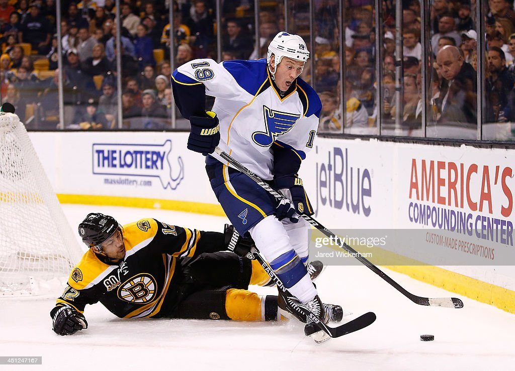 <a gi-track='captionPersonalityLinkClicked' href=/galleries/search?phrase=Jay+Bouwmeester&family=editorial&specificpeople=201875 ng-click='$event.stopPropagation()'>Jay Bouwmeester</a> #19 of the St Louis Blues carries the puck in front of Jerome Iginla #12 of the Boston Bruins in the third period at TD Garden on November 21, 2013 in Boston, Massachusetts.