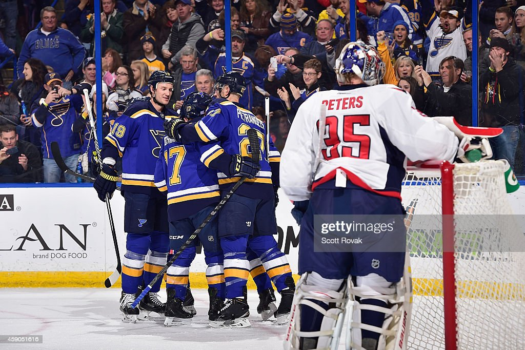 Jay Bouwmeester of the St Louis Blues celebrates with teammates after the Blues scored a goal against Justin Peters of the Washington Capitals on...