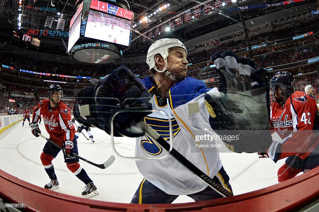 <a gi-track='captionPersonalityLinkClicked' href=/galleries/search?phrase=Jay+Bouwmeester&family=editorial&specificpeople=201875 ng-click='$event.stopPropagation()'>Jay Bouwmeester</a> #19 of the St. Louis Blues crashes into the boards against the Washington Capitals in the third period during an NHL game at the Verizon Center on November 17, 2013 in Washington, DC.