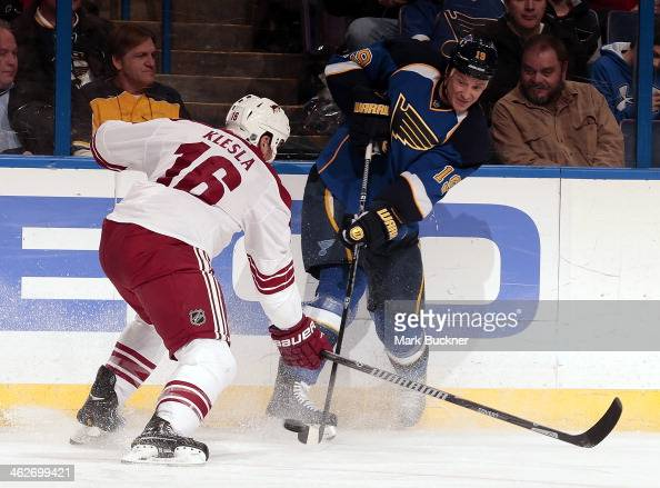 Jay Bouwmeester of the St Louis Blues fires the puck past Rostislav Klesla of the Phoenix Coyotes during an NHL game on January 14 2014 at Scottrade...
