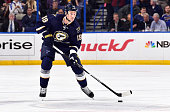 Jay Bouwmeester of the St Louis Blues handles the puck against the Buffalo Sabres on November 11 2014 at Scottrade Center in St Louis Missouri