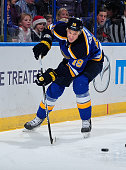 Jay Bouwmeester of the St Louis Blues handles the puck against the New York Islanders on December 11 2014 at Scottrade Center in St Louis Missouri