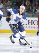 Jay Bouwmeester of the St Louis Blues handles the puck against the Dallas Stars at the American Airlines Center on April 11 2014 in Dallas Texas