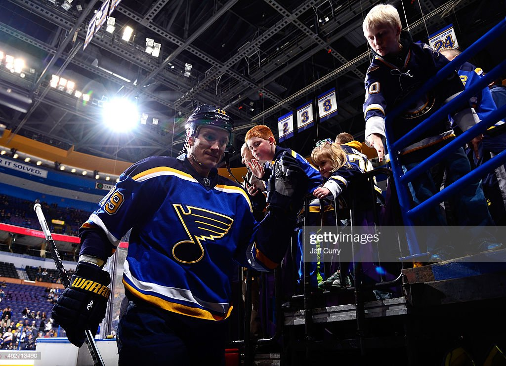 Jay Bouwmeester of the St Louis Blues high fives fans before a game against the Nashville Predators on January 29 2015 at Scottrade Center in St...