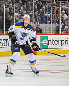 Jay Bouwmeester of the St Louis Blues keeps an eye on the play during first period action against the Winnipeg Jets at the MTS Centre on October 18...