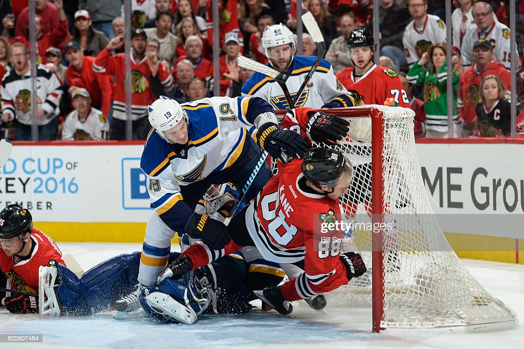 Jay Bouwmeester #19 of the St. Louis Blues pushes Patrick Kane #88 of the Chicago Blackhawks into the net in the first period of Game Four of the Western Conference First Round during the 2016 NHL Stanley Cup Playoffs at the United Center on April 19, 2016 in Chicago, Illinois.
