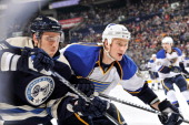 Jay Bouwmeester of the St Louis Blues races against Artem Anisimov of the Columbus Blue Jackets to a loose puck on April 12 2013 at Nationwide Arena...