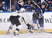 Jay Bouwmeester of the St Louis Blues shoots the puck past Paul Martin of the Pittsburgh Penguins on February 21 2015 at Scottrade Center in St Louis...