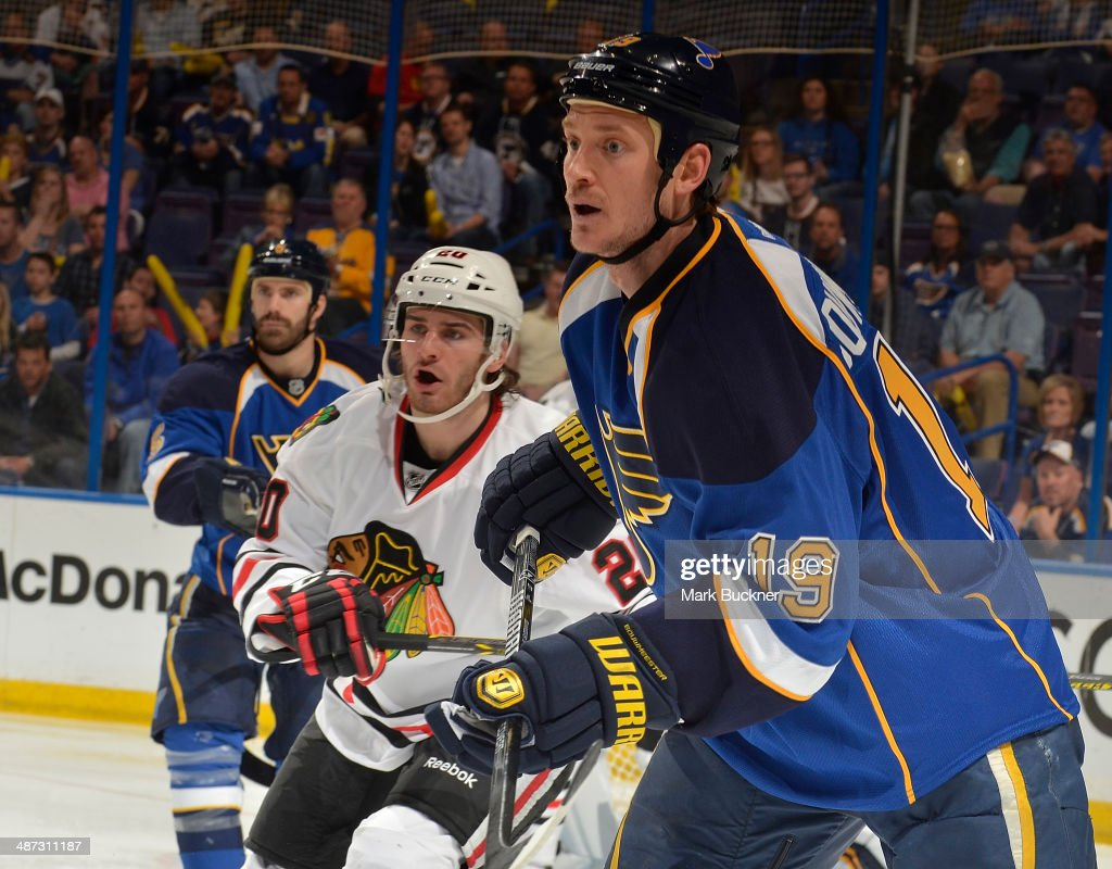 Jay Bouwmeester of the St Louis Blues skates against Brandon Saad of the Chicago Blackhawks in Game Five of the First Round of the 2014 Stanley Cup...