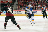 Jay Bouwmeester of the St Louis Blues skates with the puck in front of Michael Stone of the Arizona Coyotes during the first period at Gila River...