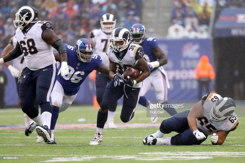 more photos cfccf 5b00c ... Jay Bromley 96 of the New York Giants tackles Todd Gurley 30 of the .