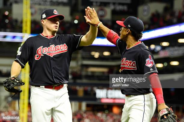 Jay Bruce and Francisco Lindor of the Cleveland Indians react in the sixth inning against the New York Yankees in Game Five of the American League...