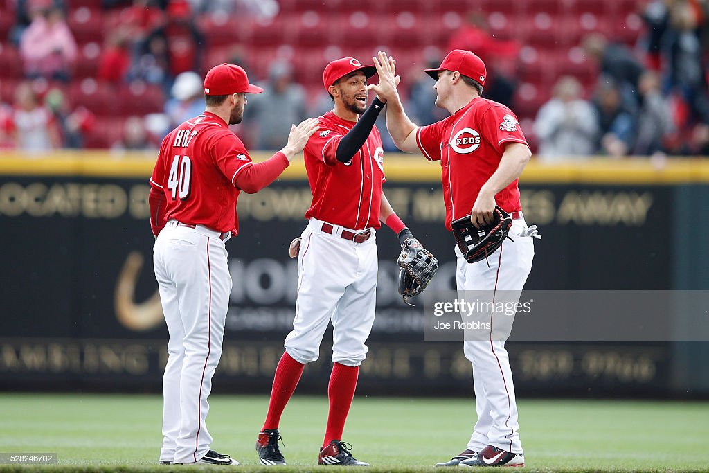 <a gi-track='captionPersonalityLinkClicked' href=/galleries/search?phrase=Jay+Bruce&family=editorial&specificpeople=4391540 ng-click='$event.stopPropagation()'>Jay Bruce</a> #32, <a gi-track='captionPersonalityLinkClicked' href=/galleries/search?phrase=Billy+Hamilton+-+Baseball+Player&family=editorial&specificpeople=3573622 ng-click='$event.stopPropagation()'>Billy Hamilton</a> #6 and Tyler Holt #40 of the Cincinnati Reds celebrate after the game against the San Francisco Giants at Great American Ball Park on May 4, 2016 in Cincinnati, Ohio. The Reds defeated the Giants 7-4.