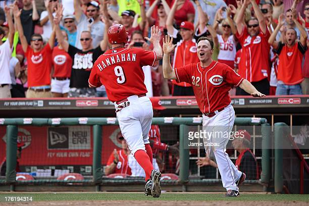 Jay Bruce celebrates with Jack Hannahan of the Cincinnati Reds after Hannahan scored the winning run against the San Diego Padres in the 13th inning...