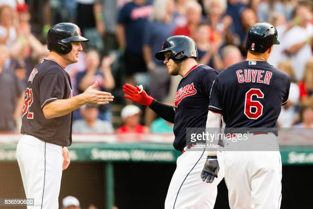 Jay Bruce celebrates with Roberto Perez and Brandon Guyer of the Cleveland Indians after all scored on a home run by Perez during the second inning...