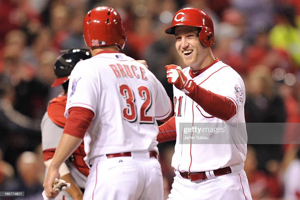 <a gi-track='captionPersonalityLinkClicked' href=/galleries/search?phrase=Jay+Bruce&family=editorial&specificpeople=4391540 ng-click='$event.stopPropagation()'>Jay Bruce</a> #32 of the Cincinnati Reds and <a gi-track='captionPersonalityLinkClicked' href=/galleries/search?phrase=Todd+Frazier&family=editorial&specificpeople=4778756 ng-click='$event.stopPropagation()'>Todd Frazier</a> #21 of the Cincinnati Reds celebrate Frazier's two-run home run in the seventh inning against the Washington Nationals at Great American Ball Park on April 5, 2013 in Cincinnati, Ohio. Frazier had two of the Reds' six home runs in a 15-0 win over the Nationals.