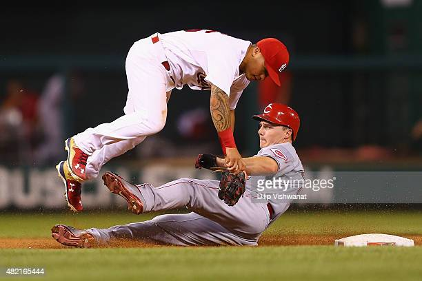 Jay Bruce of the Cincinnati Reds breaks up double play against Kolten Wong of the St Louis Cardinals in the sixth inning at Busch Stadium on July 27...