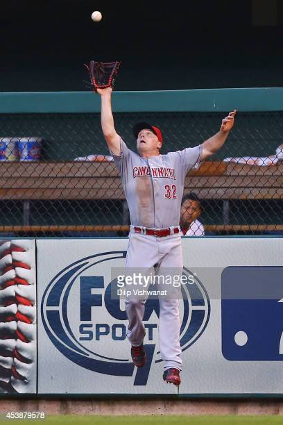 Jay Bruce of the Cincinnati Reds catches a deep fly ball against the St Louis Cardinals in the third inning at Busch Stadium on August 20 2014 in St...