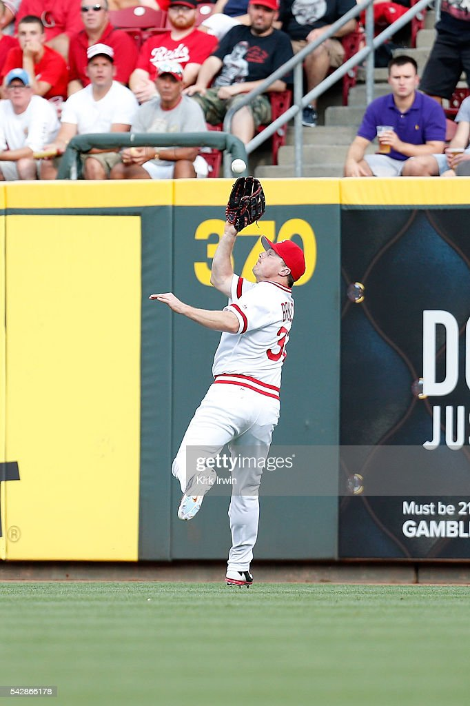 <a gi-track='captionPersonalityLinkClicked' href=/galleries/search?phrase=Jay+Bruce&family=editorial&specificpeople=4391540 ng-click='$event.stopPropagation()'>Jay Bruce</a> #32 of the Cincinnati Reds catches a fly ball hit by <a gi-track='captionPersonalityLinkClicked' href=/galleries/search?phrase=Yangervis+Solarte&family=editorial&specificpeople=9013250 ng-click='$event.stopPropagation()'>Yangervis Solarte</a> #26 of the San Diego Padres during the first inning at Great American Ball Park on June 24, 2016 in Cincinnati, Ohio.