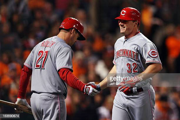 Jay Bruce of the Cincinnati Reds celebrates with teammate Todd Frazier after hitting a solo home run in the fourth inning against the San Francisco...