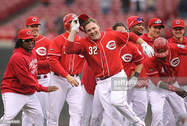 Jay Bruce of the Cincinnati Reds celebrates with teammates after driving in the winning run in the Reds 32 victory over the Houston Astros at Great...