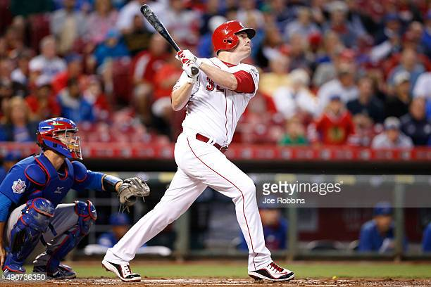 Jay Bruce of the Cincinnati Reds drives in a run with a sacrifice fly against the Chicago Cubs in the first inning at Great American Ball Park on...