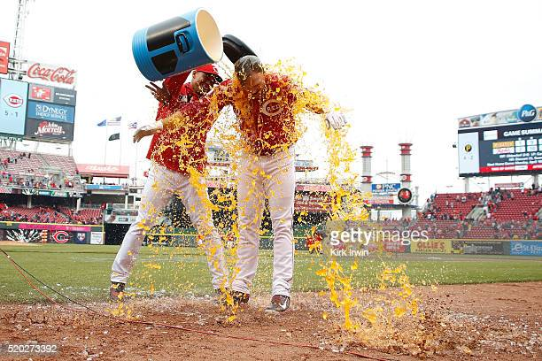 Jay Bruce of the Cincinnati Reds has a bucket of Powerade poured over him after hitting a walkoff triple to defeat the Pittsburgh Pirates 21 at Great...