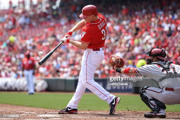 Jay Bruce of the Cincinnati Reds hits a double in the second inning against the Arizona Diamondbacks at Great American Ball Park on August 22 2013 in...