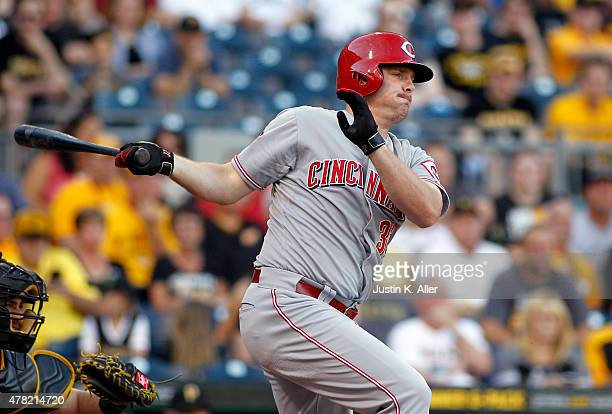 Jay Bruce of the Cincinnati Reds hits a RBI single in the first inning during the game against the Pittsburgh Pirates at PNC Park on June 23 2015 in...
