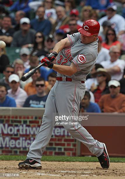 Jay Bruce of the Cincinnati Reds hits a threerun home run in the 4th inning against The Chicago Cubs at Wrigley Field on May 6 2011 in Chicago...
