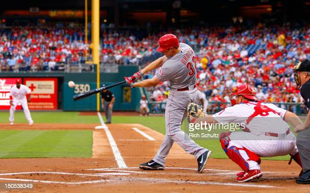 Jay Bruce of the Cincinnati Reds hits an RBI double in the first inning against the Philadelphia Phillies during a MLB baseball game on August 20...