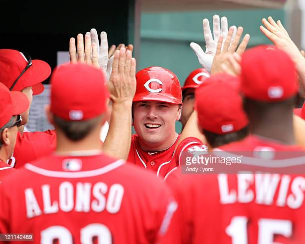 Jay Bruce of the Cincinnati Reds is congratulated by teammates after hitting a home run during the game against the San Diego Padres at Great...