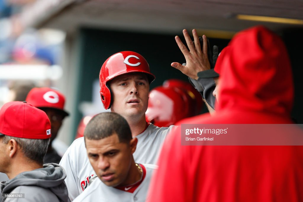 <a gi-track='captionPersonalityLinkClicked' href=/galleries/search?phrase=Jay+Bruce&family=editorial&specificpeople=4391540 ng-click='$event.stopPropagation()'>Jay Bruce</a> #32 of the Cincinnati Reds is congratulated by teammates in the dugout after hitting a home run in the second inning of the game against the Philadelphia Phillies at Citizens Bank Park on May 19, 2013 in Philadelphia, Pennsylvania.
