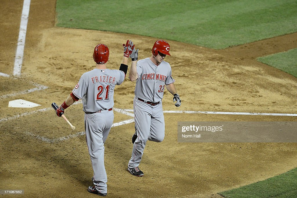 <a gi-track='captionPersonalityLinkClicked' href=/galleries/search?phrase=Jay+Bruce&family=editorial&specificpeople=4391540 ng-click='$event.stopPropagation()'>Jay Bruce</a> #32 of the Cincinnati Reds is greeted at home plate by teammate <a gi-track='captionPersonalityLinkClicked' href=/galleries/search?phrase=Todd+Frazier&family=editorial&specificpeople=4778756 ng-click='$event.stopPropagation()'>Todd Frazier</a> #21 after hitting a home run against the Arizona Diamondbacks at Chase Field on June 21, 2013 in Phoenix, Arizona.