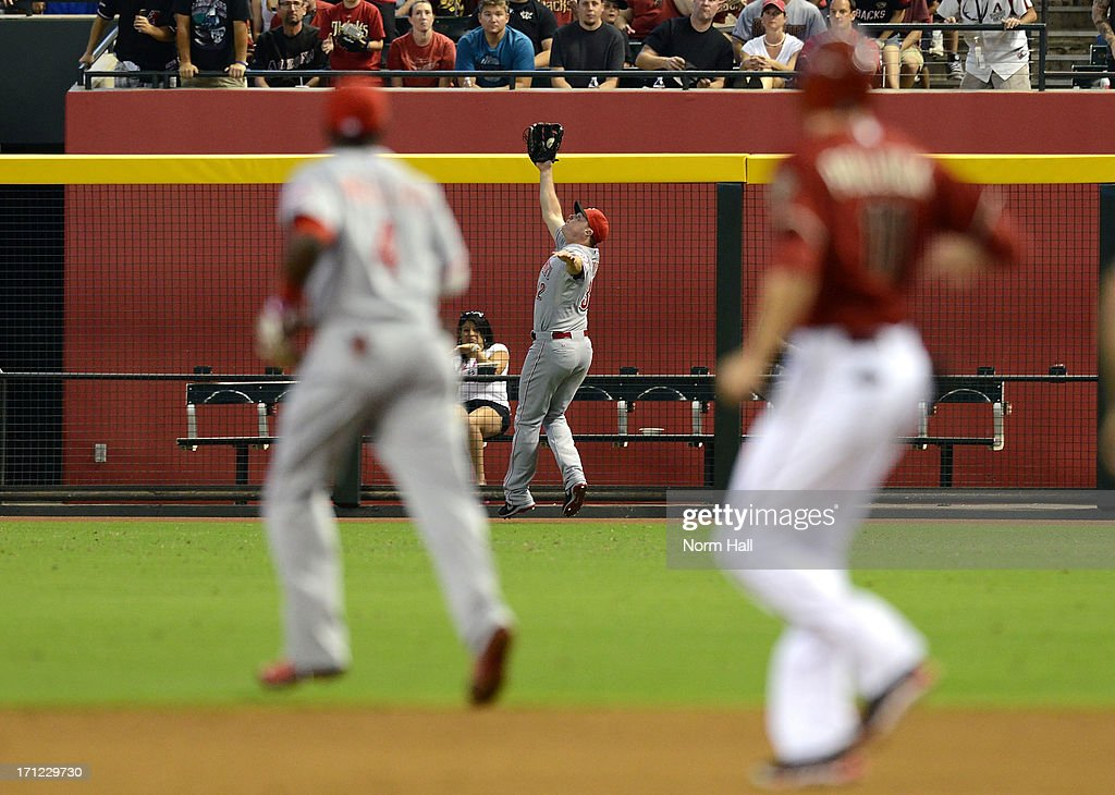 <a gi-track='captionPersonalityLinkClicked' href=/galleries/search?phrase=Jay+Bruce&family=editorial&specificpeople=4391540 ng-click='$event.stopPropagation()'>Jay Bruce</a> #32 of the Cincinnati Reds makes a play on a fly ball just in front of the right field fence against the Arizona Diamondbacks at Chase Field on June 23, 2013 in Phoenix, Arizona.