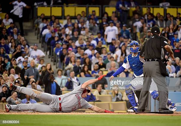 Jay Bruce of the Cincinnati Reds reacts after being tagged out by Yasmani Grandal of the Los Angeles Dodgers attempting to sttretch an RBI triple...