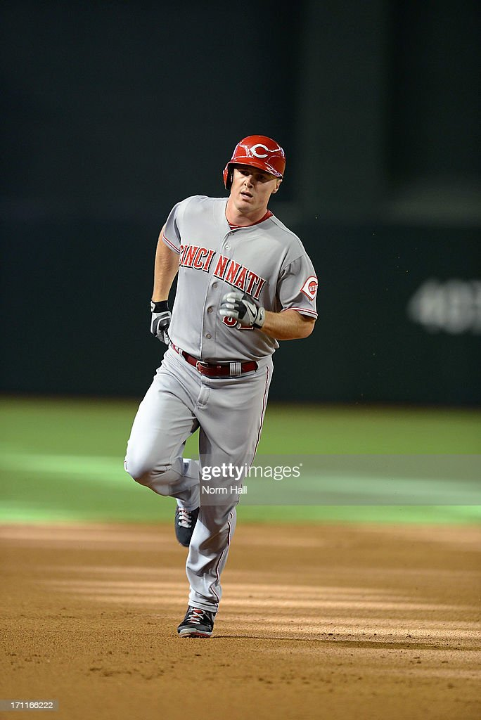 Jay Bruce #32 of the Cincinnati Reds rounds the bases after hitting a second inning home run against the Arizona Diamondbacks at Chase Field on June 22, 2013 in Phoenix, Arizona.