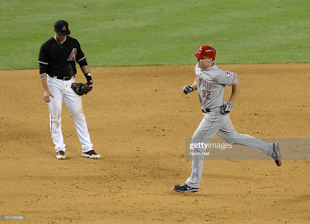 <a gi-track='captionPersonalityLinkClicked' href=/galleries/search?phrase=Jay+Bruce&family=editorial&specificpeople=4391540 ng-click='$event.stopPropagation()'>Jay Bruce</a> #32 of the Cincinnati Reds rounds the bases after hitting his second home run of the game as <a gi-track='captionPersonalityLinkClicked' href=/galleries/search?phrase=Martin+Prado&family=editorial&specificpeople=620159 ng-click='$event.stopPropagation()'>Martin Prado</a> #14 of the Arizona Diamondbacks hangs his head at Chase Field on June 22, 2013 in Phoenix, Arizona.